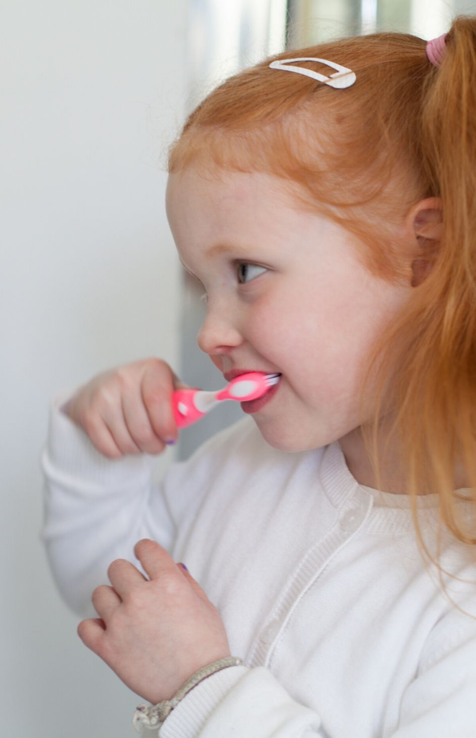 Safe+Sound Health's Kids Toothbrush with timer in pink