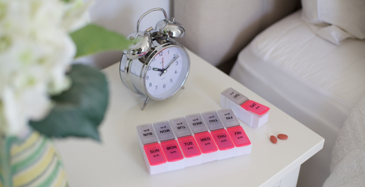 Safe and Sound Health twice-daily weekly pillbox in bedroom helps you keep on-top of your medication