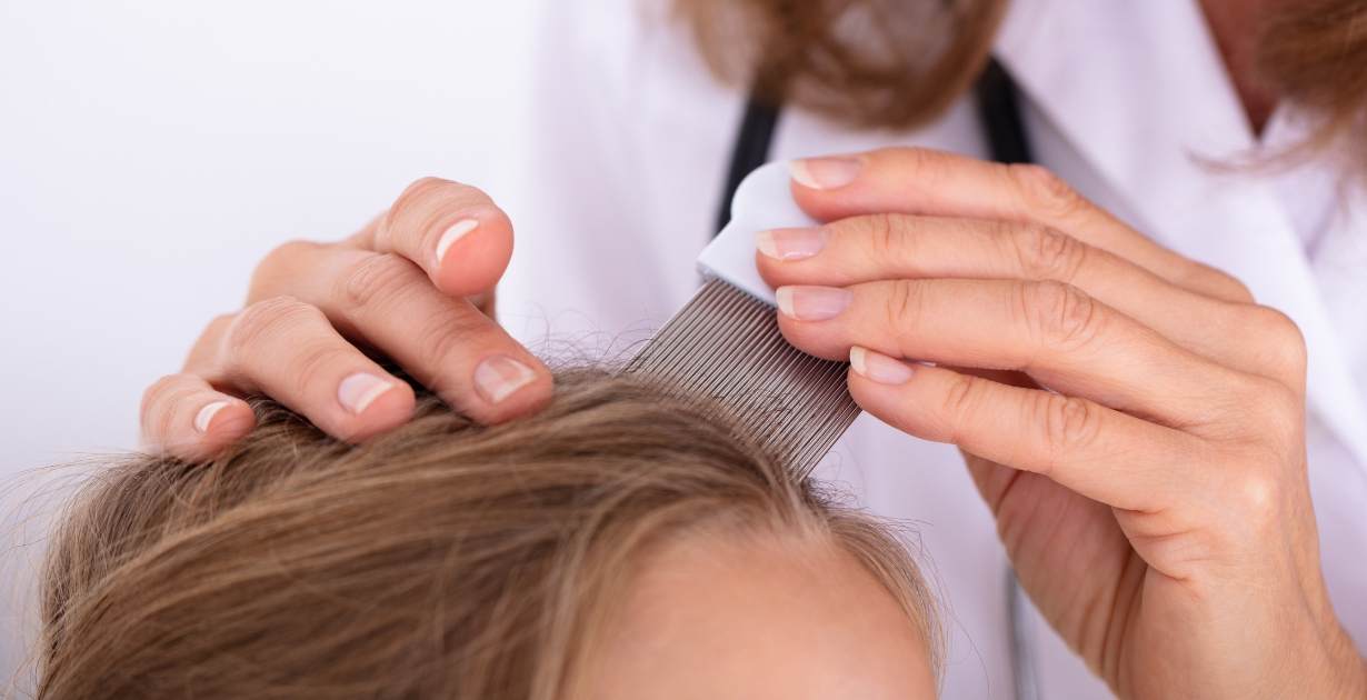 Parent using a Safe and Sound Health nit comb to remove headlice from daughters hair